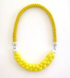 yellow rope necklace - sunny statement necklace in yellow - spring braided cotton rope and yarn necklace  This rope necklace is so sunny and bright that people around you will need sunglasses :)    Made with a cotton handwoven rope in mustard yellow and a 100% soft organic cotton braid in a brighter yellow shade. Wear this awesome rope and braid necklace and let it work its magic on your mood!    Fastens easily with a silver plated metal hook clasp and makes a bright statement. The rope is…
