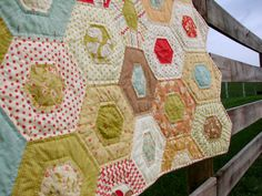 SALE Hexagon Quilt Hand Quilted in Moda Whimsy collection. $250.00, via Etsy.  Shop: lovequilt