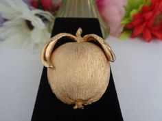 Vintage Goldtone Trifari Signed Apple Brooch. The Pin Measures 2.5 inches Tall The Pin Measures 1 inch wide. CCCsVintageJewelry.com Free Shipping to the US. New Listing. Signed Trifari.