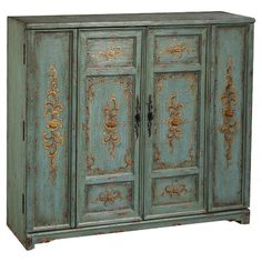 French inspired wood cabinet in antique teal finish.   Product: CabinetConstruction Material: WoodCo...