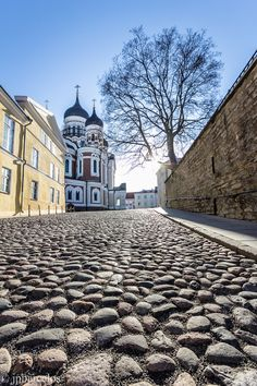 Tallinn, Estonia (by João Barcelos) - cobblestone street with Alexander Nevsky Cathedral at the summit of the street