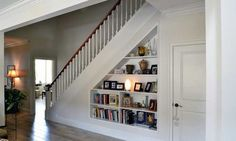 Home Design: When building a home, you may be surprised by all the choices, including staircase style and location. Get helpful staircase design tips. Shelves Under Stairs, Stair Bookshelf, Closet Under Stairs, Basement Stairs, Bookshelves, Modern Staircase, Staircase Design, Spiral Staircases, Foyers
