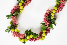 7 of Hawaii's most popular lei, and what makes them unique Hawaiian Leis, Hawaiian Flowers, Red And Green Make, Orchid Lei, Ti Plant, Singular And Plural, Flower Lei, Succulents In Containers, Purple Orchids