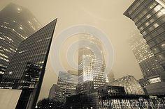 Financial or corporate highrise building towering through two walking pedestrian bridges