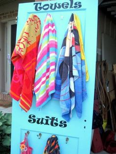 NO more hanging bathing suits over the back of your patio chairs or the side of the bathtub. Take an old door, dress it up with brightly colored paint, add some hooks and cool lettering, and you ha…