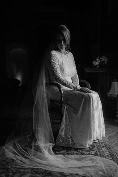 Moody black and white portrait of a bride sitting in a chair Olivia & Dan Photography - Spanish Wedding