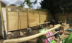 The fencing being installed | Jacksons Canterbury Combi fence panels #fence #garden #design