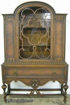 photo of antique ornate burl walnut dome top china cabinet