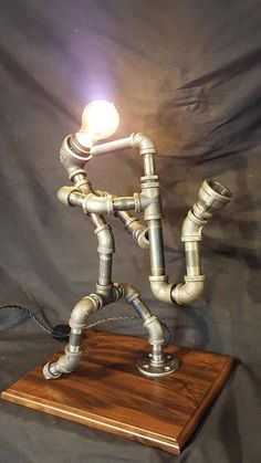 Handmade lighted sculpture that is made from black industrial plumbing pipe. This can act as room lighting while showing your love of music. The saxophone player as a lighted sculpture is the perfect conversation piece for any home. This lighted sculpture measures approximately 24