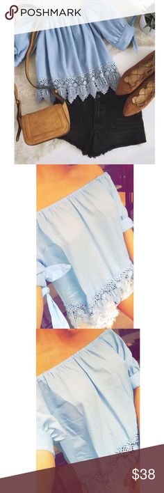TAHITIAN BLUE TOP Baby blue top with side bows and lace trim detail . Very comfortable and chic with an off shoulder detail . Size small . New comes with shopping box. Brandy Melville Tops Blouses