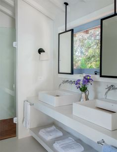 sleek bathroom design with ceiling mounted hanging mirrors