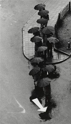 poetry of rain.  André Kertész, Racing Day in Tokyo, 1968