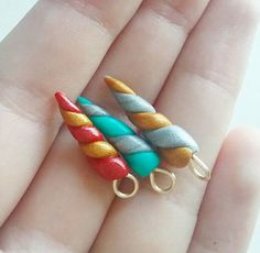 Check out this item in my Etsy shop https://www.etsy.com/listing/479330422/polymer-clay-unicorn-horn-charms-kawaii