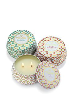 Unwinding with a relaxed ambiance created by these Voluspa two-wick tin candles.