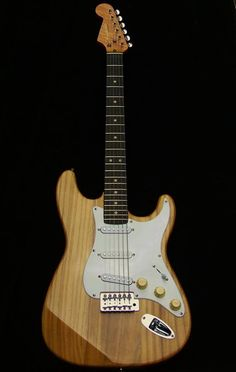 Haywire Custom Guitars Custom Shop Stratocaster Specs: Right hand Extra-Light weight Swamp Ash Strat plus left hand neck. The construction of the neck: Wood: Birdseye Maple/Ebony fret board 5 Way Switching includes-3 Single Coil and 2 Humbucking Modes