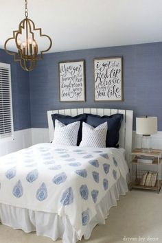 Blue bedroom with unique song lyric art kellyelko.com