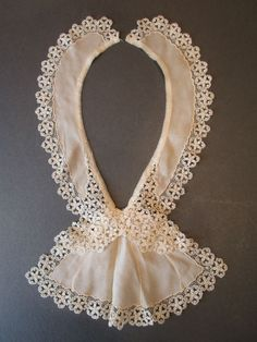 https://www.pinterest.com/deridi2014/antique-lace-and-crochet-collar/    c1900 ANTIQUE EDWARDIAN CREAM SILK COLLAR / JABOT WITH FLORAL LACE TRIM