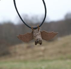 Needlefelted bat necklace #bat // motleymutton at etsy. Now that I can needlefelt, I can make my own bat toys!