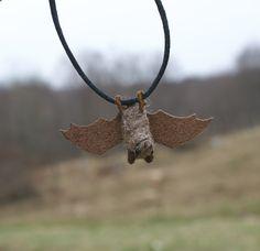 Needlefelted bat necklace #bat // motleymutton at etsy.    Now that I can needlefelt, I can make my own bat toys!