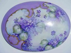 Ann Zitterkopf Studio - Studies from Annzitterkopfstudios.com.  Notice the way that she handled the oval platter with the open and closed areas, and the opaque lavender, and gold used as framework-Superb space design.