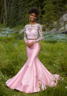 Two-Piece Prom Dress with Larissa Satin Mermaids Skirt. Net Top Accented with Floral Printed Lace and Long Sleeves. Colors Available: Pink/Multi, White/Multi