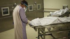 Noua lege a morţilor: eprubetă în sicriu, braţară pentru decedat, mai multă şcoală pentru
