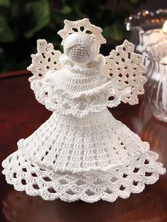 "Stitch a beautiful crochet angel for the holidays or to be used year-round.   This beautiful angel is made using size 10 crochet thread and a size 7/1.65mm steel crochet hook. Finished size is 7"" tall including halo."