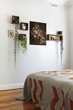 Love everything about this. The shelves, the plants, the bedspread!