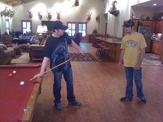 Dale Jr and Martin Truex Jr playing pool