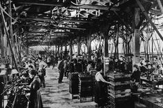 Circa 1916: Women work in a French munitions factory