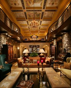 Elaborate beams surround stunning frescoes in this grand home.  Strategically placed lighting fill the space with a gentle glow without being intrusive to the architectural elements.   © Harwick Homes 2012.  Interior design by House of Harmony.  Photo by Doug Thompson Photography.  Eric Brown Design Group a/k/a Palladian Design Group architects.