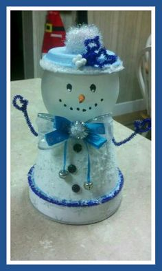 Snowman candy dishes out of clay pots