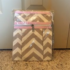 NWOT Chevron Crossbody bag NWOT Chevron Crossbody bag Pink/Gray/White Perfect to Monogram initials on Front zipper pocket & top zipper pocket. Adjustable strap. Still in original plastic bag, only taken out for photo. Item comes from smoke free and pet friendly home. Please ask if you have questions. Bags Crossbody Bags