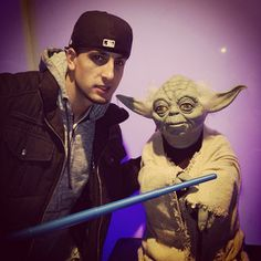 Jesse is at star wars party in NYC with his homie yoda.