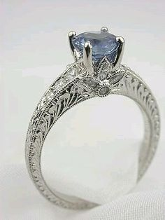 Sapphire Jewelry Sapphire Ring with Flower Motif.not sure this pic is sapphire. A deeper blue would look stunning. Diamond Engagement Ring with Flower Jewelry Rings, Jewelery, Jewelry Accessories, Fine Jewelry, Jewelry Design, Designer Jewelry, Pandora Jewelry, Gold Jewellery, Geek Jewelry