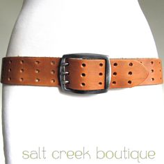 vintage full grain genuine leather, wider width, triple prong metal buckle, punched holes, tooled, biker, rocker, boho, western style, jeans, mens, womens belt in camel tan. available now at Salt Creek Boutique on eBay!