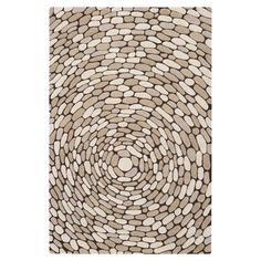 Hand-tufted wool rug with a pebble motif.   Product: RugConstruction Material: 100% WoolColor: De...