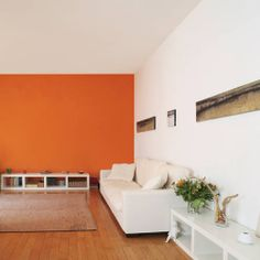 Be bold and go for a bright colour this season: paint one feature wall for a sophisticated look.