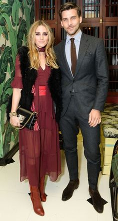 Olivia Palermo in a burgundy midi dress, fur vest and brown boots (with hot husband Johannes Huebl)