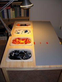 more lego storage ideas...ooo have mike cut holes in Lego table??