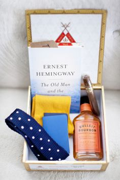 'groomsman box' - prepared for each groomsman and given the day of the wedding, with necessities like their bowtie and socks, and niceties like a cigar and mini bottle of bourbon. {Style Me Pretty}  I can see Tyler doing this for some reason!