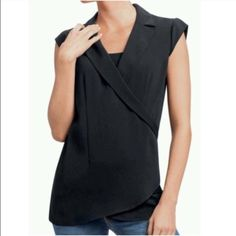 """CAbi Faux Wrap Top Crossover """"Origami"""" Black Sz M  Cabi   Faux wrap, """"Origami"""" top. """"Rendered in a wrap design, this clean-cut top contours the torso for a flattering fit.""""   Size M   Excellent used condition!    Polyester   Bust: 19.25"""" across the front, lying flat. Has stretch.   Length: 29.5"""" from shoulder to hem   ✳️ Bundle to Save 20%! ❌ No Trades, Holds, PP, Modeling  100% Authentic!  ⭐️⭐️ Suggested User • 1200+ Sales • Fast Shipper • Best in Gifts Party Host! ⭐️⭐️ CAbi Tops"""