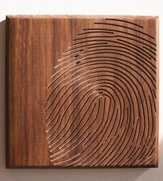 Fingerprint wood art. Give it to a friend. Then, they're one step closer to breaking into your secret vault.