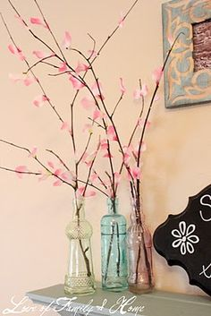 Cute cherry blossom branches. Neat idea for the mantle.