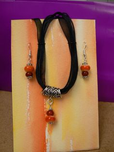 Orange lampwork bead necklace and earrings set for Kathy.