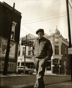 James Dean walking the streets of Fairmount, Indiana while visiting in 1955.