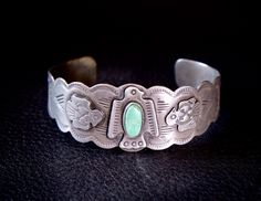 "Fred Harvey Thunderbird Sterling Silver & Turquoise Bracelet.Original Fred HARVEY 1930s NAVAHO Sterling Silver Cuff Bracelet, has appliquéd and stamped Thunderbirds with a oval turquoise stone. Measures 1"" high. Measures 6 3/4 "" around inside including the gap and is adjustable. Weight 28.7 grams. by FarRiderWest on Etsy"