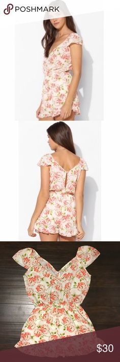 Urban Outfitters Pins and Needles Floral Romper This is a Pins and Needles floral romper from Urban Outfitters. It is in great condition and is a size medium. Pins & Needles Pants Jumpsuits & Rompers