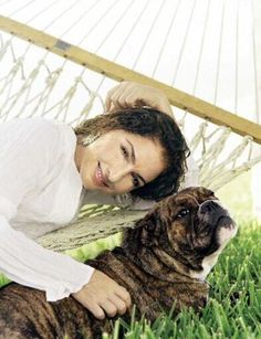 Grammy-winning singer Gloria Estefan poses with her dog in an undated photo provided by Rayo, part of Harper Collins Publishers