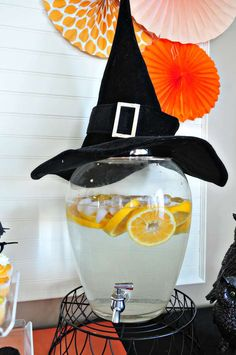 Decorate your drinks dispenser at your Halloween Party with a witches hat to gi Halloween Housewarming Party, Halloween Bunco, Halloween Cocktails, Holidays Halloween, Halloween Crafts, Halloween Decorations, Halloween Foods, Halloween Ideas, Witch Theme Party